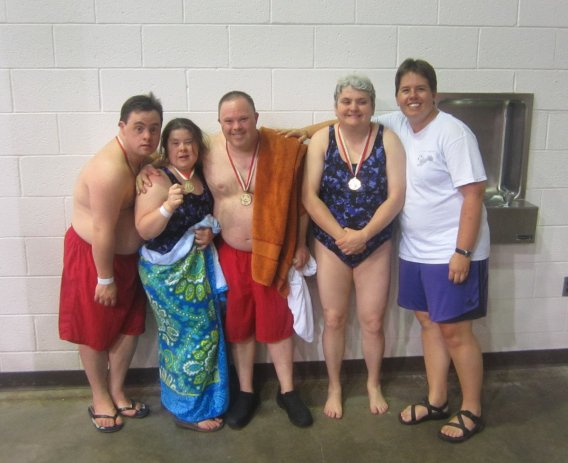 Andy poses with friends after the 2013 Summer Games. Contributed by Rosemary Mahon, Hamden-New Haven swimming coach.